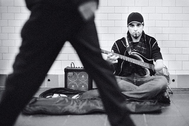 Photograph of a one-armed guitarist, Times Square Subway, Manhattan, NY, by Judith Ebenstein