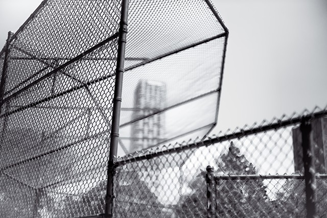 Photograph of a baseball fence with 1214 Fifth Avenue in the background, Central Park, Manhattan, by Judith Ebenstein