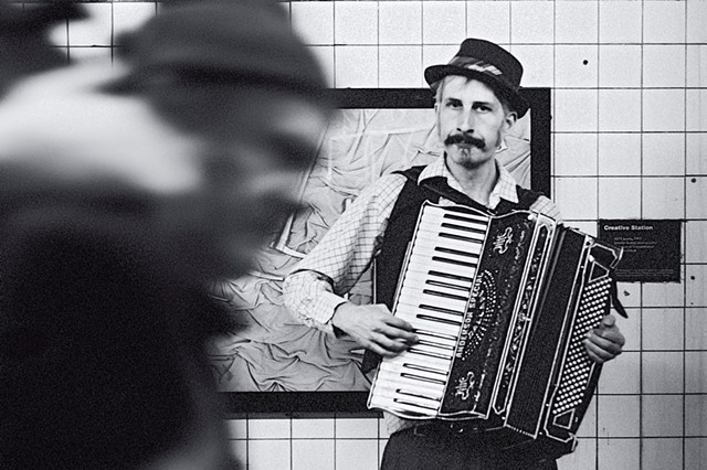 Photograph of an Old World Accordionist, 14th Street Subway Station, Manhattan, New York, by Judith Ebenstein
