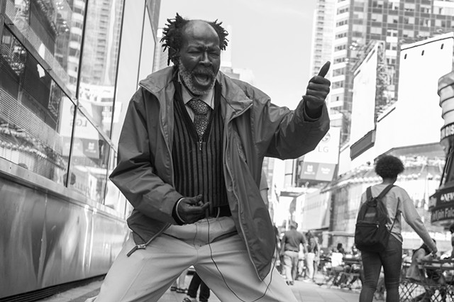 Photograph of a dancer, Times Square, Manhattan, NY, by Judith Ebenstein