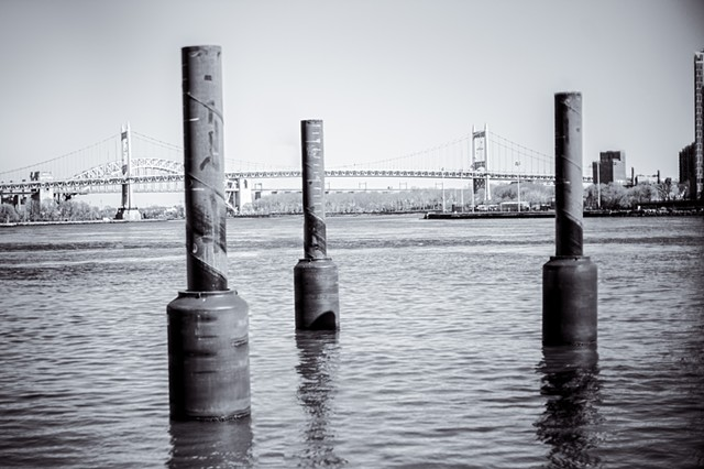 Photograph of Marine Pillars, East River, RFK Bridge, and Hell Gate Bridge, Manhattan, NY, by Judith Ebenstein