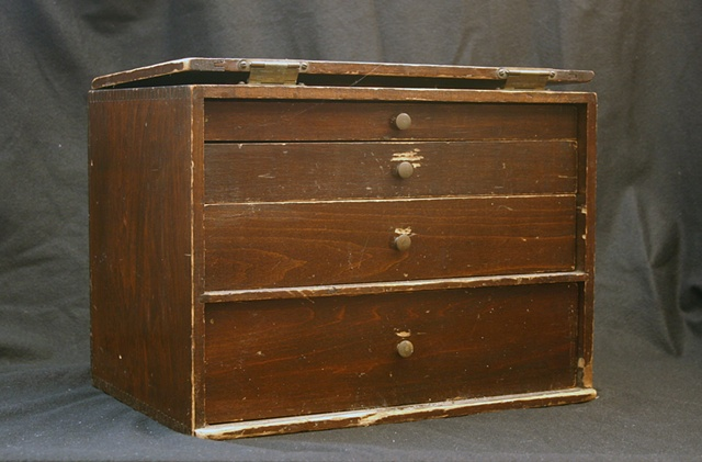 Found silverware box with 4 drawers of various size, filled with black pigmented wax