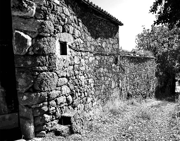 """Bodega Along the Path"" The rugged rock wall of a bodega next to a path represents a typical scene in Galicia"