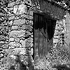 """Rock Wall with Wooden Door""  Remains of an old house in Trasulfe, Spain"