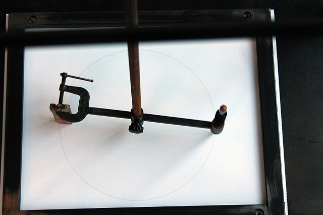 "'Continuum' (2010) Lawrence LaBianca Steel, bearings, paper, pink pearl erasure, pencil, motorized fan, growing archive of drawings. 87"" x 36"" x 36"" (drawing machine) 24-hour based 17"" x 14"" time/date stamped drawings"