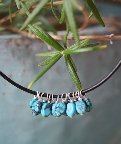 turquoise charm necklace on black leather cord