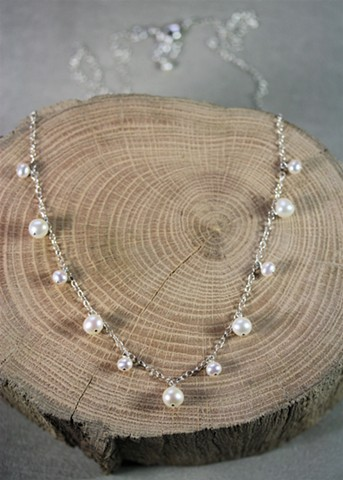 long pearl charm necklace
