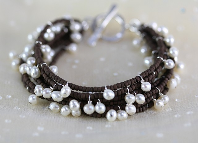 multi-strand bracelet with brown seed beads and pearls