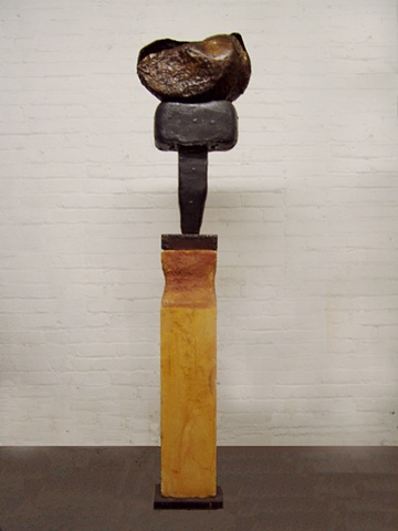 a mixed media Sculpture in bronze iron and Limestone based on a composition by Isumu Noguchi