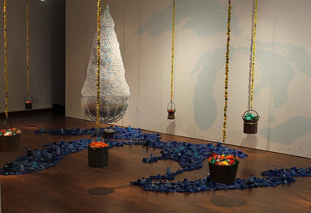 environmental art, water rights, trash, bottle caps, installation