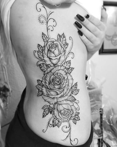 Side flower tattoo