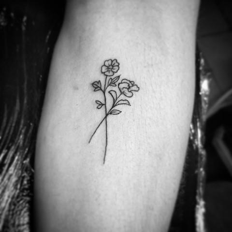 Minimal flower tattoo