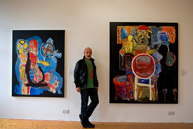 The Artist Gerry Gleason with some of his paintings.