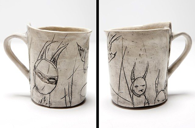 Mug with creatures