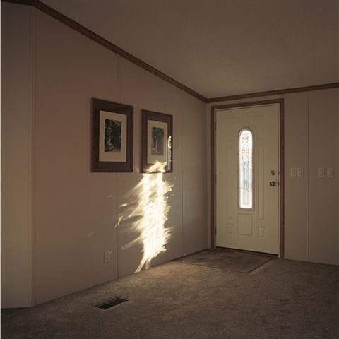 Entryway with light flare, manufactured display home, © Amy Eckert www.amyeckertphoto.com
