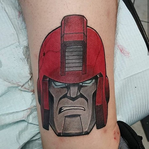 Ironhide, ironhide tattoo, transformer, g1 transformers, 80s cartoon, transformer tattoo, Kissimmee tattoo shop, tattoos, tattooing, Kissimmee tattoo