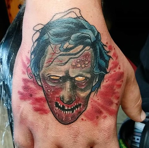 Zombie head, zombie head tattoo, hand tattoo, Kissimmee tattoo, Kissimmee tattoo shop, tattooshop, tattooing