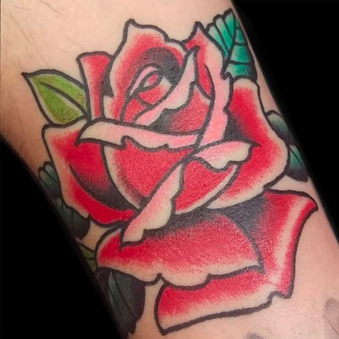 Color traditional tattoo of Rose on lower arm by Gina Marie of Copper Fox Tattoo Company in Kissimmee Florida