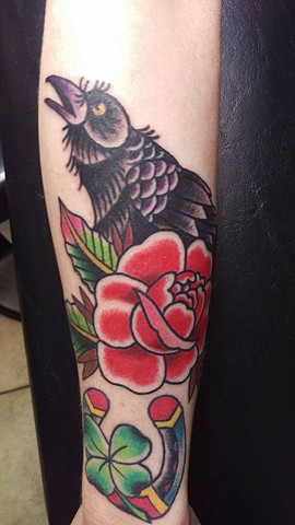 Tradtitional Rose and Raven on lower arm by Gina Marie of Copper Fox in Kissimmee Florida