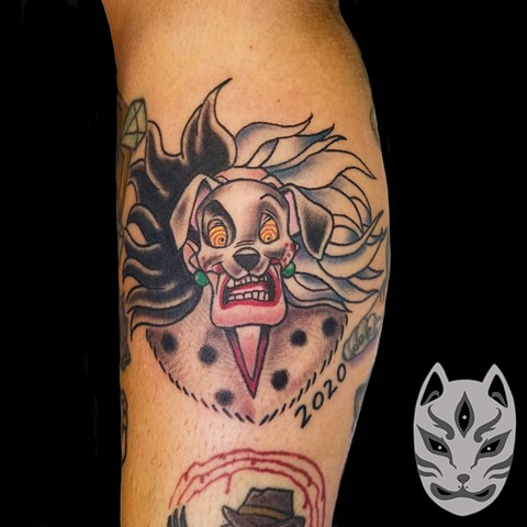 Disney Cruella De Vil from 101 Dalmations tattoo on lower leg in traditional style