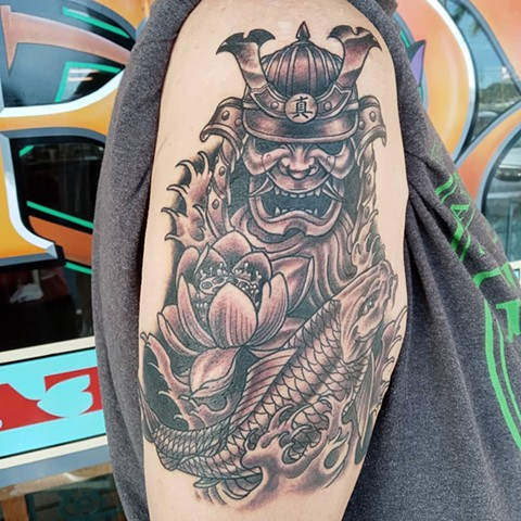 Black and grey tattoos, samurai helmet tattoo, samurai mask tattoo, lotus flower, lotus flower tattoo, lotus tattoo, koi, koi fish, koi fish tattoo, finger waves, finger waves tattoo, waves, wave tatto, tattoo shop, tattoo, Kissimmee tattoo shop, Kissimme