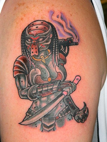 Female Predator tattoo on upper arm in full color by Berol Landskroner of Copper Fox Tattoo Co