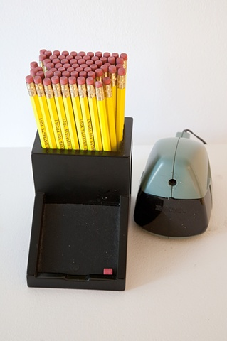 Free pencils which feature same questions that appeared on chairs in downstairs gallery space
