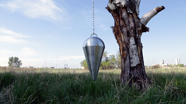 Pendulum attached to a tree for site reading