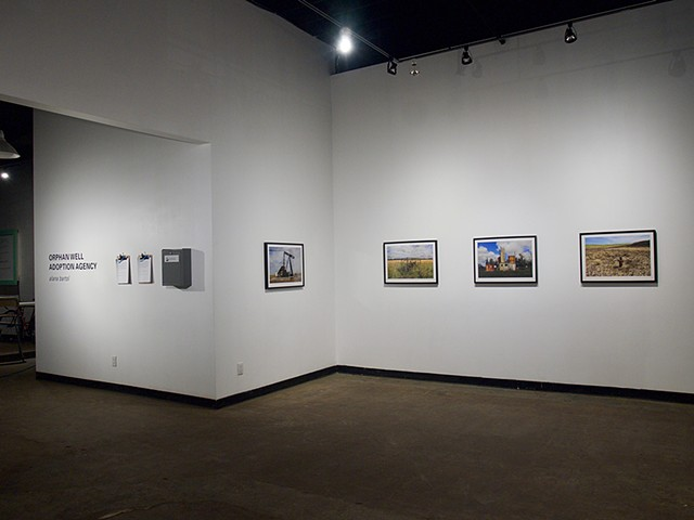 Orphan Well Portraits and Adoption Application Dropbox Installation View, Latitude 53