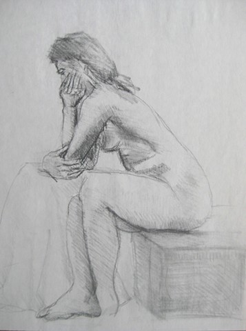 Seated Figure with Box and Table