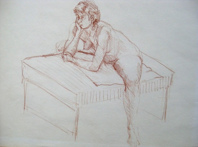 Female Leaning on Table