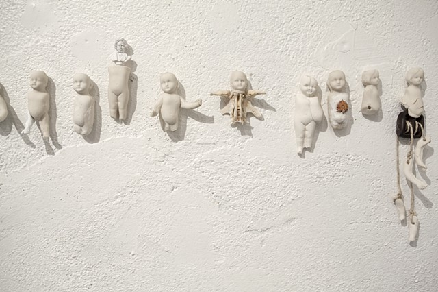voodoo dolls, porcelain slip cast, mixed media installation, lauren carter