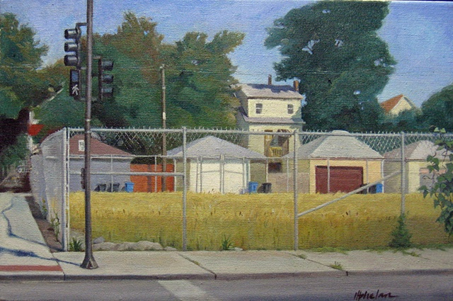 urban corner with empty lot surrounded by chainlink fence and view of garages and trees in late summer  by Mary Phelan