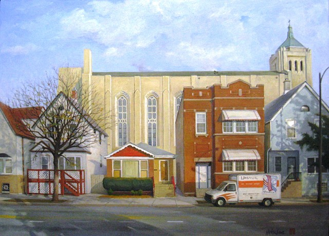 Small Chicago bungalow squeezed between much larger buildings and backed by soaring church, with U-Haul truck by Mary H. Phelan.