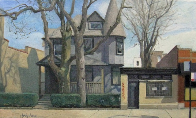 grey victorian house tucked between brick commercial buildings with large trees and strong shadows by Mary Phelan