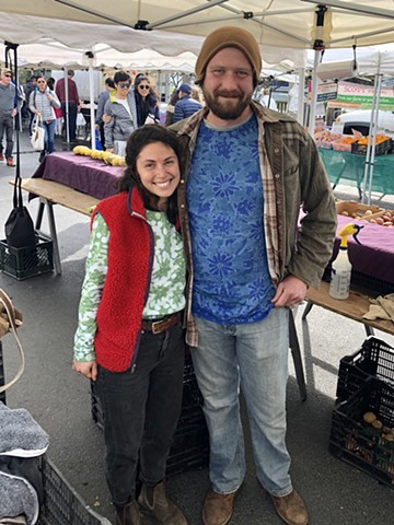 Farmers Michael and Bree Selling at Market in T-Shirts