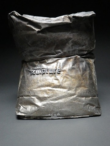 Cast aluminum sculpture sand bag