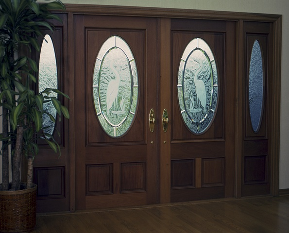 Carved, etched, beveled and glue chipped glass doors.