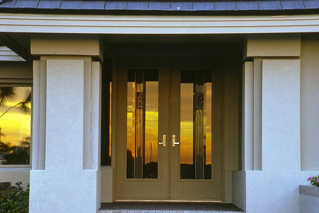 Beveled glass entry doors.