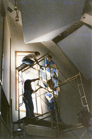 Installing art glass/stained glass in a church.
