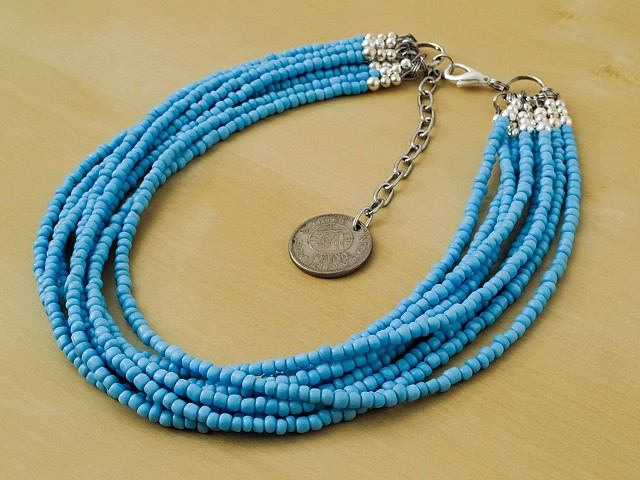 8 Strand Light Blue Glass