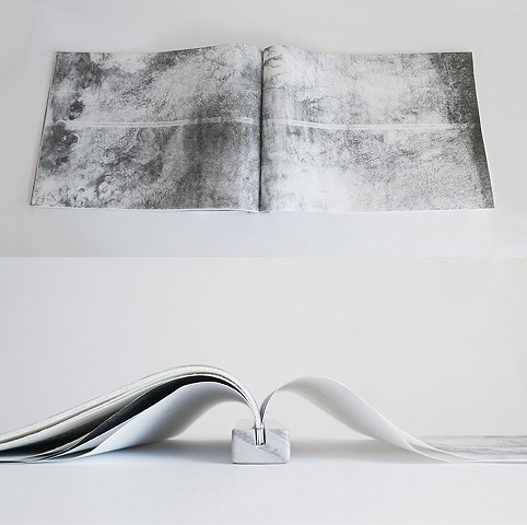 Undare Book in marble holder and collophon spread