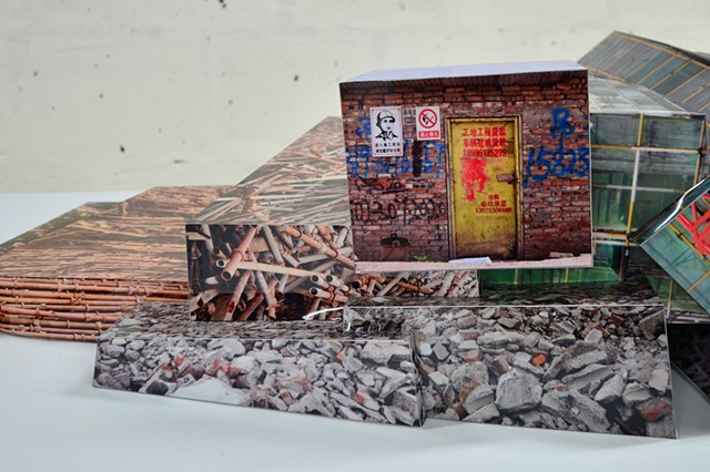 Photo-collage sculpture using worksite textures from Chongqing, China.
