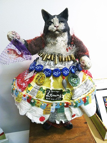 Cat in a new dress- raku ceramics and recycled stuff -lisa schumaier