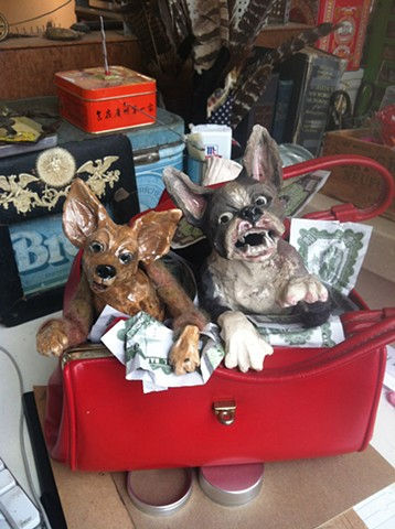 Ceramic boston terrier and chihuahua terrorise a purse