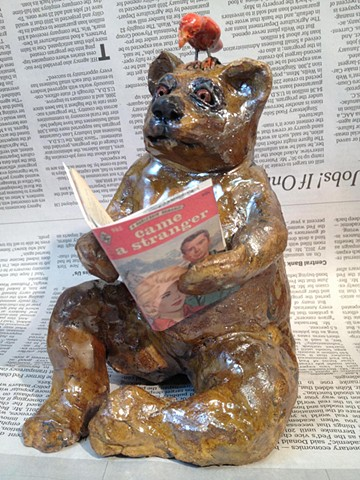 raku bear sharing a smutty read with his bird friend by lisa schumaier