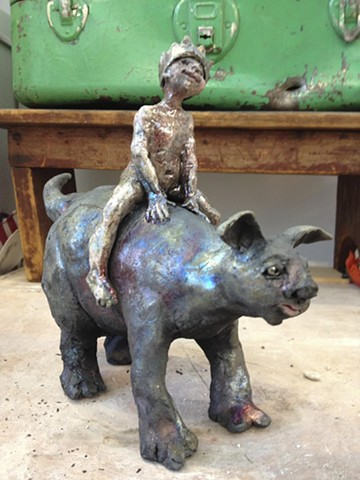 Raku boy riding a monster-Lisa Schumaier