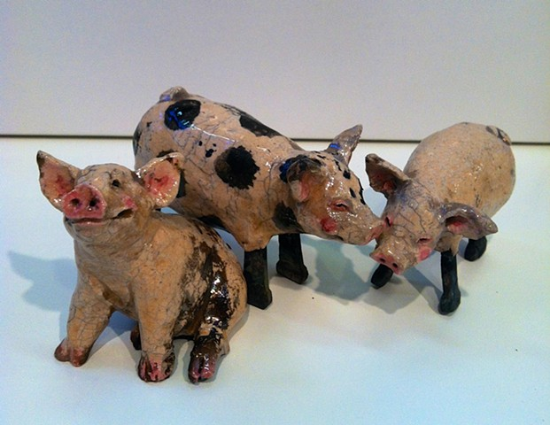 small ceramic pigs