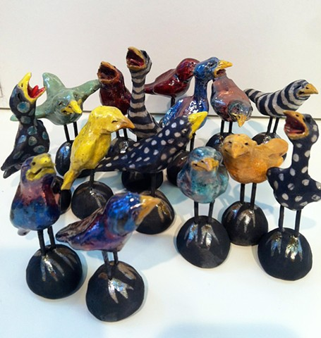 small raku glazed birds