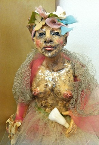 the tooth fairy is made of raku, animal teeth and antique fabric. by lisa schumaier